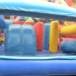Kids playing in the bouncy castle; Annex Festival on Bloor