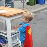Superman kneads dough at the Annex Festival